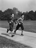 Two Smiling Boys Running Carrying School Books