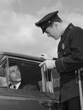 Police Officer Warning Motorist Pointing Finger at Driver