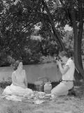 Teenage Couple Picnic Boy Taking Photograph of Girl Outdoors