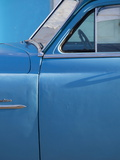 Detail of Vintage Blue American Car Against Painted Blue Wall