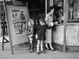 Mother and 2 Children Buying Tickets to Movie Matinee Boy Wearing Cowboy Costume