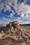 Red and White Sandstone Formations under Clouds