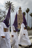 Penitents During Semana Santa (Holy Week) Beneath Torre Del Oro  Seville  Andalucia  Spain  Europe