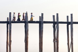 Local Women Walking across U Bein Bridge Behind