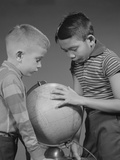 Two Boys Studying Earth Globe
