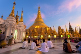 Shwedagon Paya (Pagoda) at Dusk with Buddhist Worshippers Praying