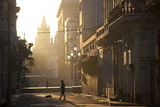 Backlit Street at Dawn with People in Semi-Silhouette