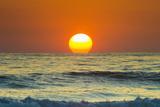Sun Touching Horizon at Sunset
