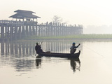 Fisherman on Taungthaman Lake in Mist at Dawn with U Bein Bridge