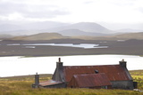 Farmhouse with Red Iron Roof Overlooking Lochs and Mountains Off the A858 South of Carloway