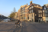 Cyclist Crossing a Bridge over Keizersgracht Canal  Amsterdam  Netherlands  Europe