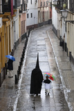 Penitents During Semana Santa (Holy Week) Along Rainy Street  Seville  Andalucia  Spain  Europe