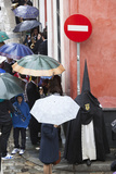 Penitent During Semana Santa (Holy Week) Along Rainy Street  Seville  Andalucia  Spain  Europe