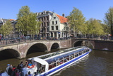 Tourist Boat Crossing the Keizersgracht Canal  Amsterdam  Netherlands  Europe
