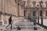 A Woman Walks Through the Louvre Museum in Paris  France  Europe