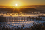 Winter Sunset over the Somerset Levels on a Misty Evening with Snow on the Ground Somerset  UK