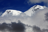 Mount Elbrus Surrounded by Clouds  Seen from Mount Cheget in the Morning  Caucasus  Russia