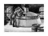 Brewer Adding Hops to Boiling Beer in an American Brewery