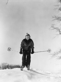 1930s Woman Holding Ski Poles Skiing in Snow