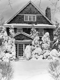 1940s Three Story Shingle Style House with Pine Trees and Shrubs Covered with Snow