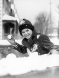 1920s-1930s Smiling Boy About to Throw Toss Snowball Playing Snow Fun Winter Cold Mischief