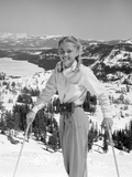 1940s 1950S Young Blond Athletic Woman Smiling Standing with Ski Poles Top of Mountain