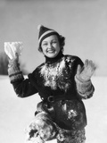 1930s Smiling Young Woman Covered in Snow Throwing Piece of Snow Squinting