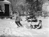 1950s Woman Mother Pulling Boy Son on Sled in Winter