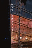 Tugboat Bow and Lowered Anchor Chain