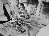 Family Cracks Crab around the Table in Boston  Massachusetts  USA Ca 1948