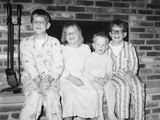 Siblings Perch on a Hearth in Pajamas  Ca 1970
