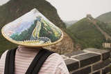 Tourist Wearing Illustrated Conical Hat on the Great Wall