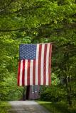 American Flag Hanging Above Gravel Road