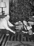 Father with Daughter and Son in Front of Christmas Tree  Ca 1950
