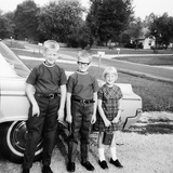 A Lineup of Kids by the Family Car 1965