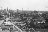 Men Survey Damage Done by Tornado