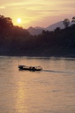 Wooden Boat on Mekong River at Sunset