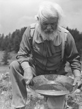 Old-Time Gold Prospector with Pan in Hands