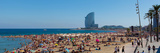Tourists on the Beach with W Barcelona Hotel in the Background  Barceloneta Beach  Barcelona