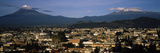 Aerial View of a City a with Mountain Range in the Background  Popocatepetl Volcano  Cholula