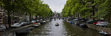 Boats in a Canal  Amsterdam  Netherlands