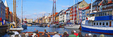 Tourists in a Tourboat with Buildings Along a Canal  Nyhavn  Copenhagen  Denmark