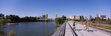 Bicyclists Along the Sacramento River with Tower Bridge in Background  Sacramento