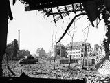 American Tank Amid Rubble in Street of German City
