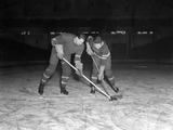 1940s-1950s Ice Hockey Players Fighting for the Puck
