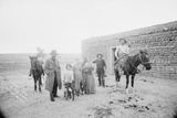Portrait of Family in Front of Ranch