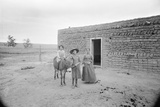 Women and Child Outside Ranch House