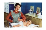 1940s Mother with Her Baby on a Changing Table in a Nursery
