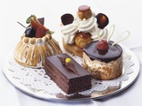 French Pastries on Silver Plate with Doily