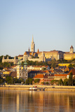 Along Danube River Towards Buda Hill and the Martyas Church Illuminated at Sunrise  Budapest
